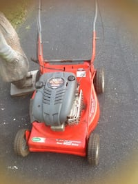 red and black  Intek walk behind lawnmower 17 km