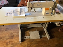 Xheda sewing machine table.
