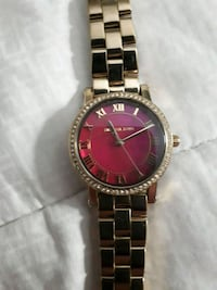 round silver and red analog watch with silver link North Vancouver, V7P 3K4