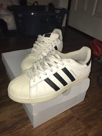 Pair of white adidas superstar shoes size 10 549 km