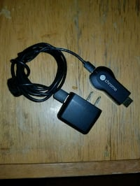 black Google Chrome Cast with charger Amsterdam, 12010