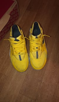 pair of yellow Nike basketball shoes New York, 10453