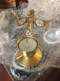 gold-colored angle candle holder