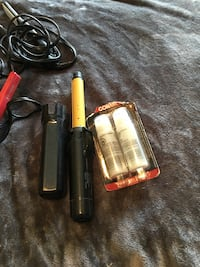 Portable curling iron, with two replacement propane