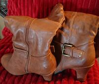 pair of brown leather boots sizes 6 and a half