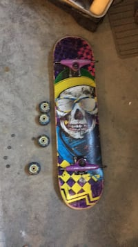 Blue, red, and yellow skateboard 7.5 inches wide Vernon, V1H 1P5