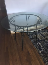 "Glass top dining room table with black metal base, 45"" round"