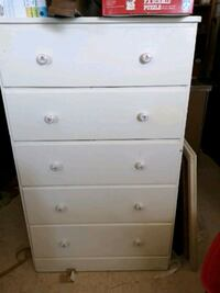 white wooden 5-drawer chest