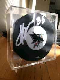 Autographed signed puck Calgary, T2N 1S4