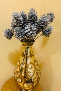 vase with spray painted pine cone