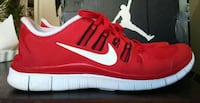pair of red-and-white Nike athletic shoes - size 9