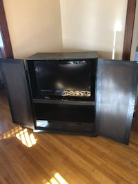 black flat screen TV with black wooden TV stand 915 mi