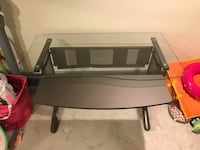 Glass and black metal desk with movable shelf for keyboard. In good condition.