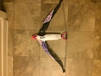 black, white, and purple plastic bow toy