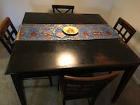 rectangular brown wooden table with four chairs dining set Murfreesboro