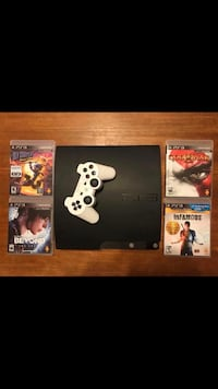 black Sony PS3 slim console with controllers and game cases Tallahassee, 32309