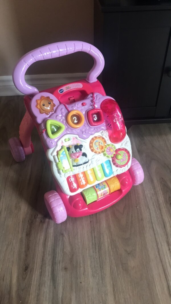 pink and purple Vtech learning walker