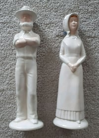 Two white ceramic  Amish figurine