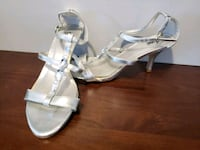 pair of gray leather open-toe heeled sandals Calgary, T2W 1C8