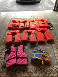 7 adult and 2 childrens life vests