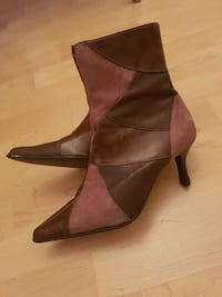 women's pair of brown leather kitten heeled boots