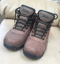 Pair of brown-and-black hiking boots 19 mi