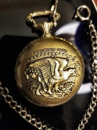 1920 s bronze colored double eagle pocket watch.