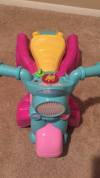 toddler's pink, yellow, and green trike Reston, 20190