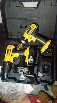 two dewalt corded and cordless hand drill in case