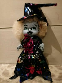 Cute plastic creepy witch doll