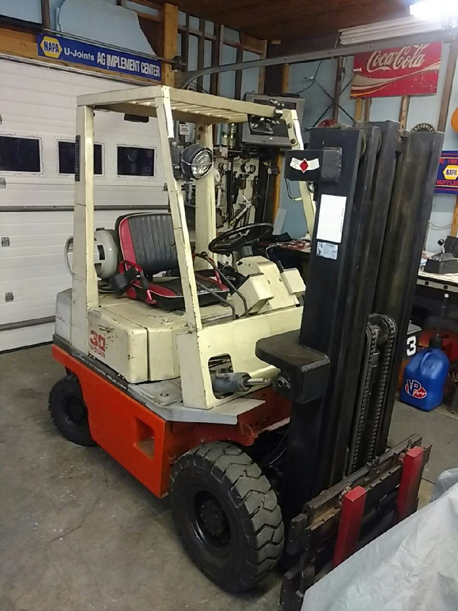 red white and black fork lift
