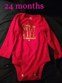 red and gold long sleeve onesie Clifford
