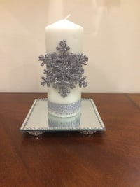 silver-colored snowflakes accent pillar candle