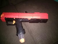 red and black plastic gun toy