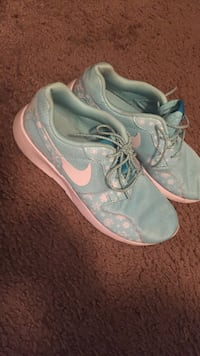 pair of teal and white nike sneakers Indianapolis, 46268