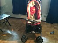 red, black, and gray stroller