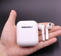 white Apple AirPods in case New York, 10030