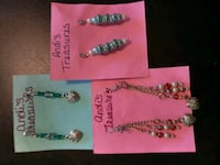 three assorted beaded bracelets with boxes Foley, 63347