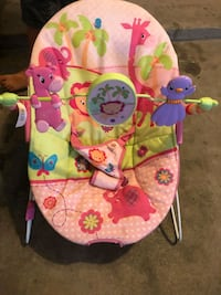 baby's pink and green bouncer El Paso, 79936