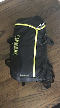 black and yelow Camelbak Snoblast bag