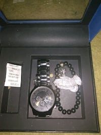 round silver chronograph watch with silver link bracelet in box Raleigh, 27616
