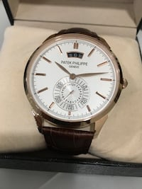round silver-colored analog watch with brown leather strap Mississauga, L5J 2E7