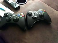 two black Xbox 360 controllers St. Charles, 60174
