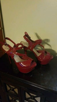 pair of red open-toe ankle strap heels