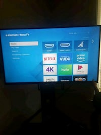black flat screen TV with remote with glass stand Gulfport, 39501