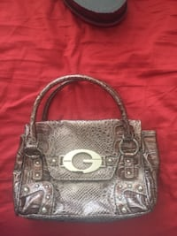 gray and black leather handbag Surrey
