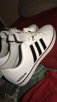 pair of white Adidas Superstar 442 mi