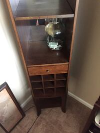 brown wooden display glass cabinet