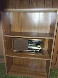 brown wooden TV hutch with flat screen television North Little Rock, 72118