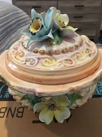 pink, beige, and blue floral ceramic pot with lid 13 km